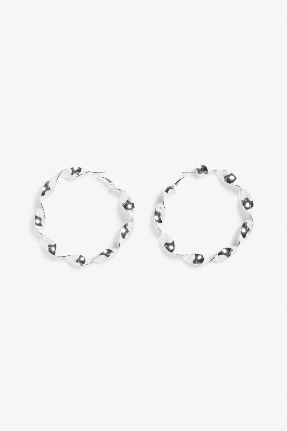 Front image of Monki twirly hoop earrings in silver