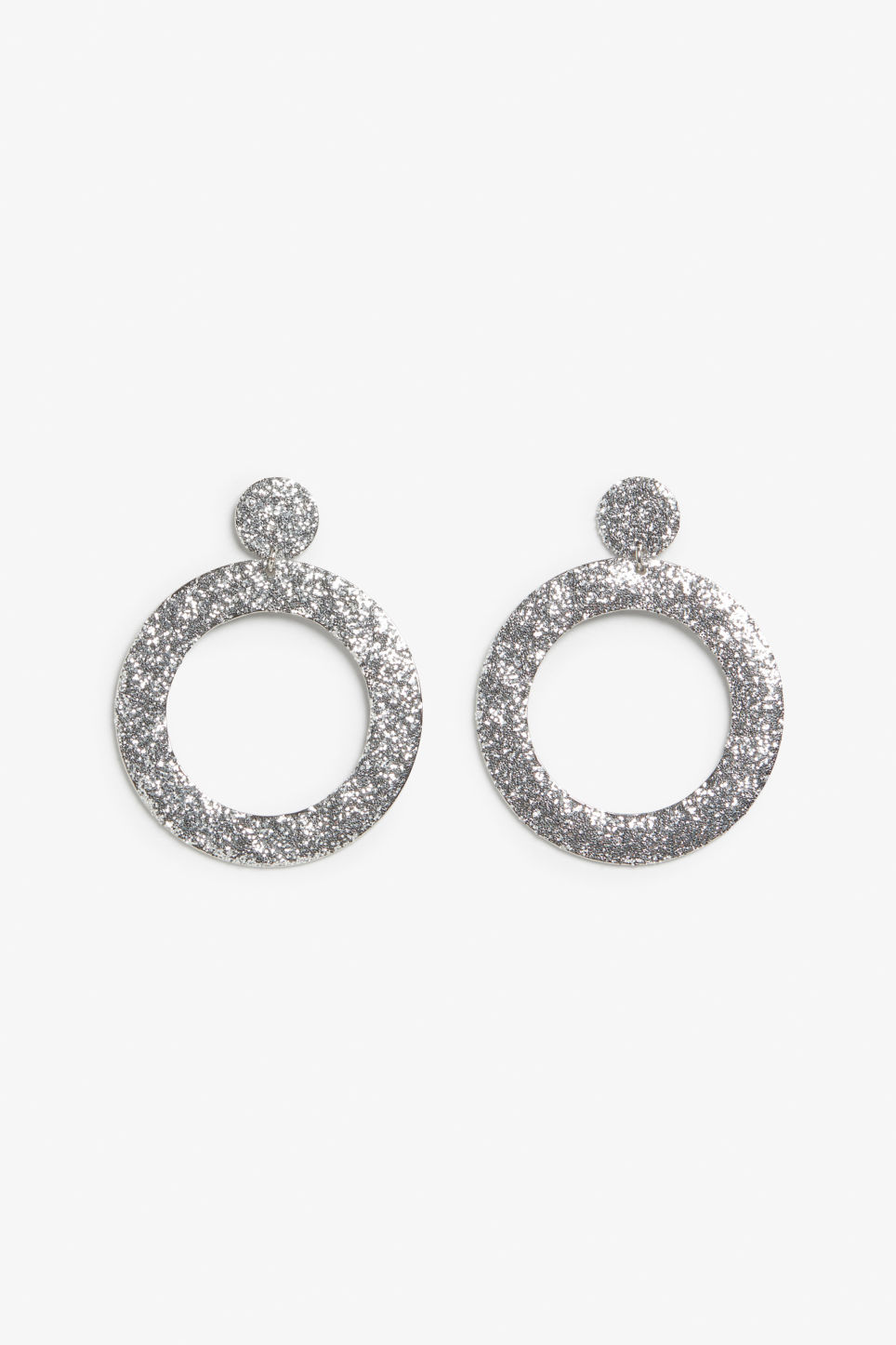 Front image of Monki glitter circle earrings in silver