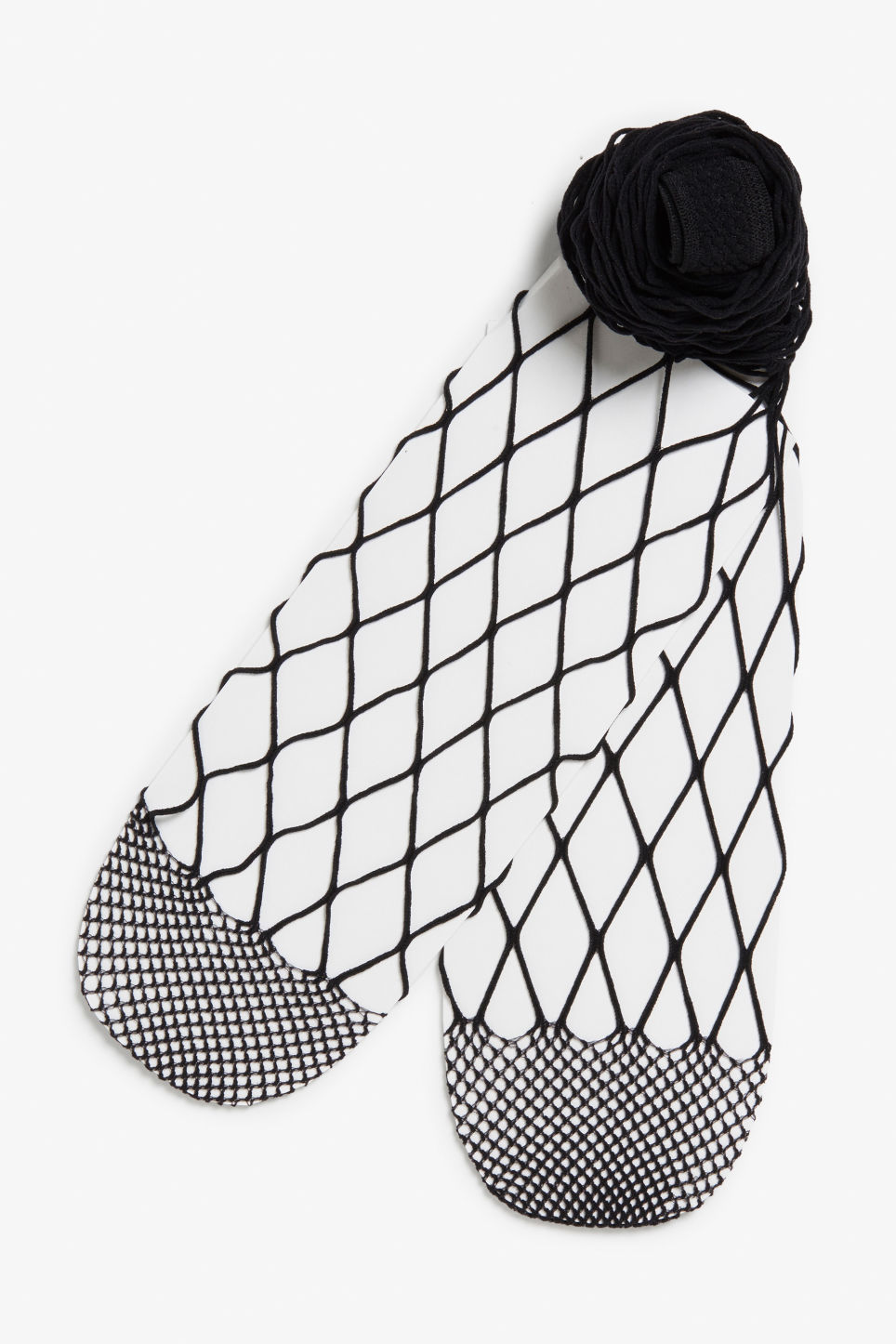 Front image of Monki large fishnet tights in black