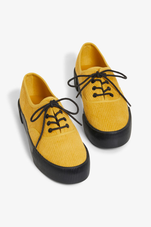 Front image of Monki lace-up sneakers in yellow