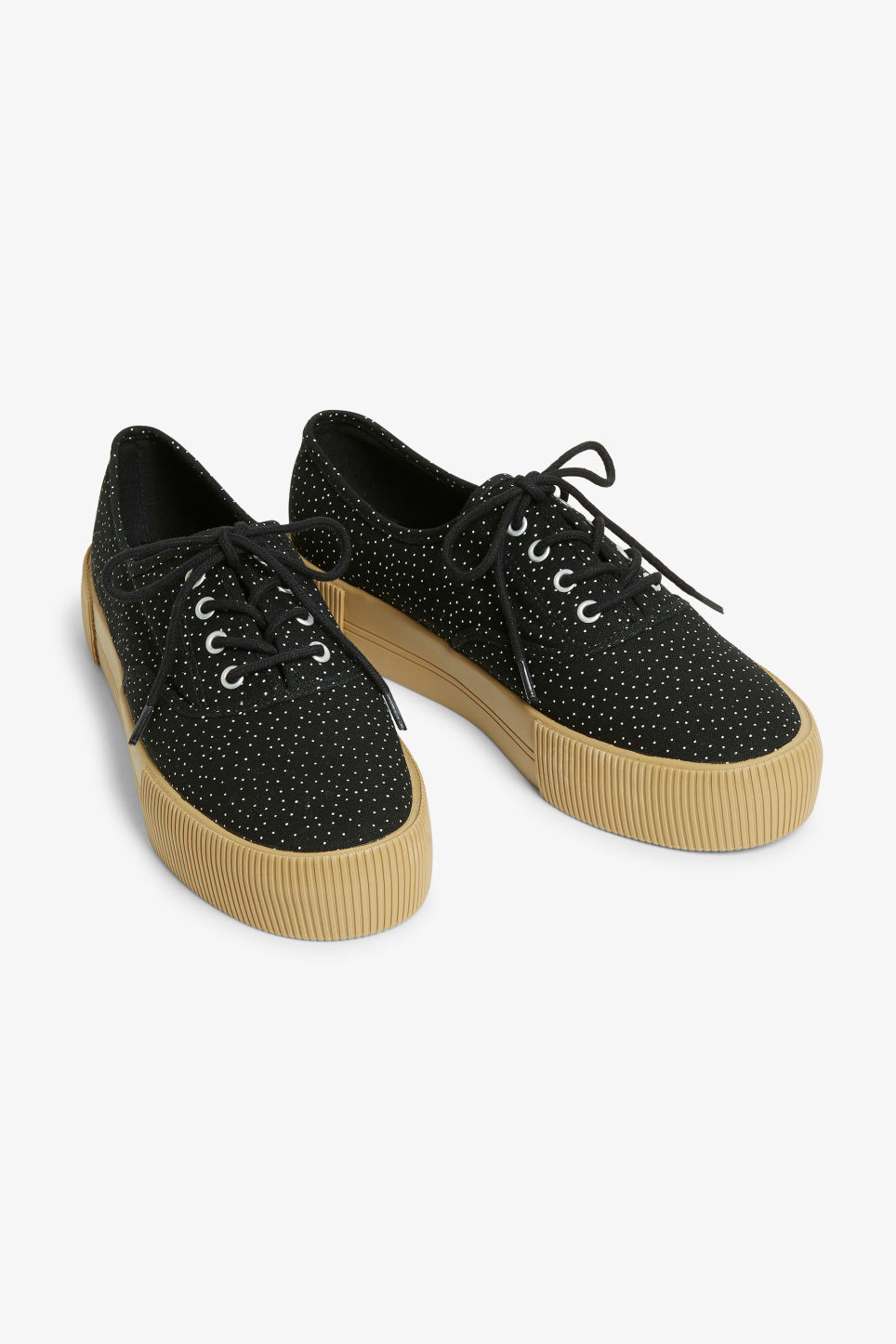 Front image of Monki lace-up sneakers in black