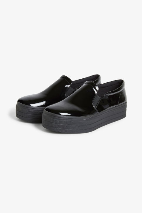 Front image of Monki flatform slip ons in black