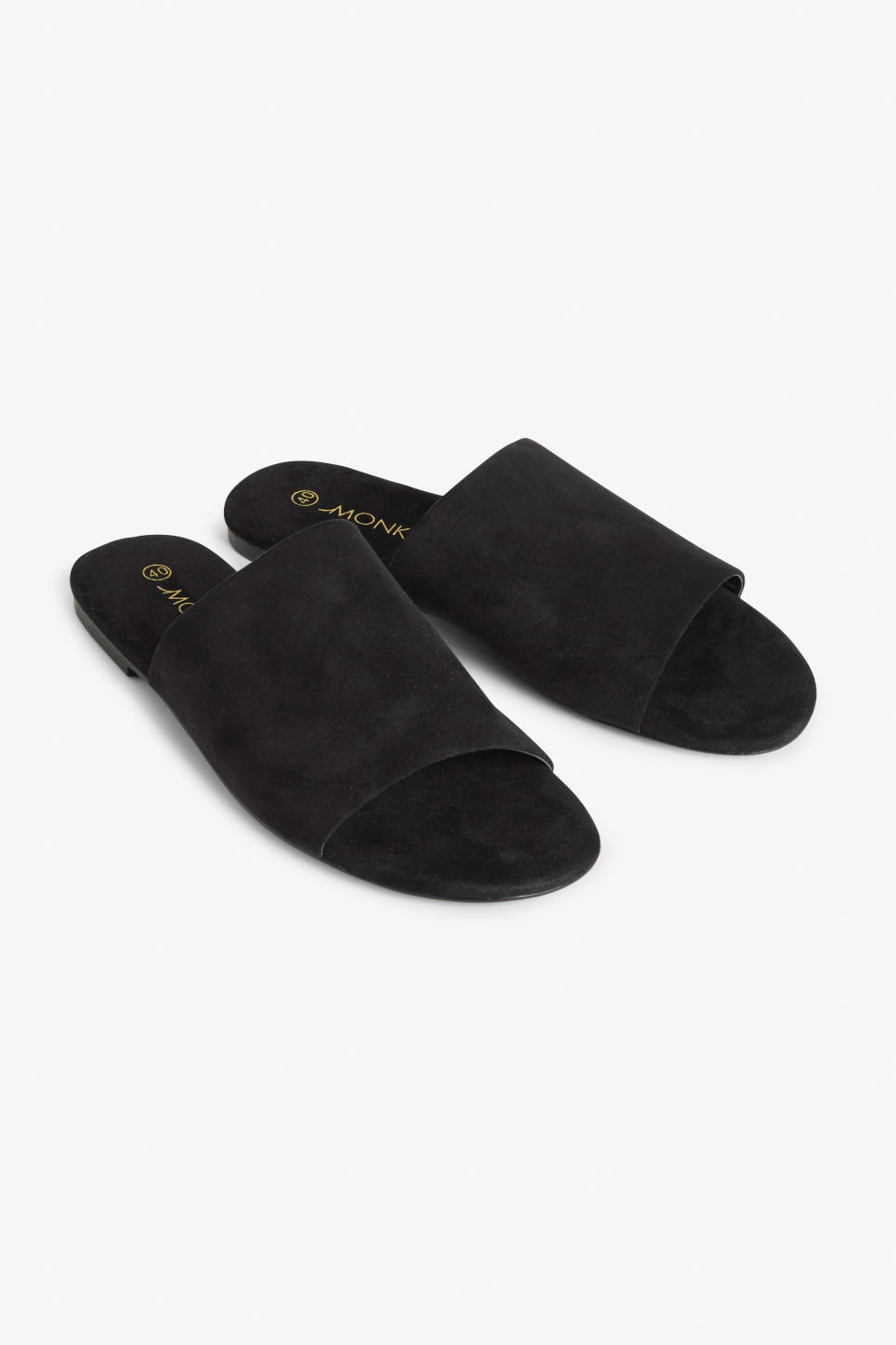 Front image of Monki slippers in black