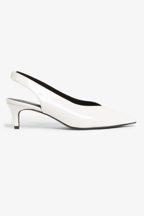 Front image of Monki slingback kitten heels in white