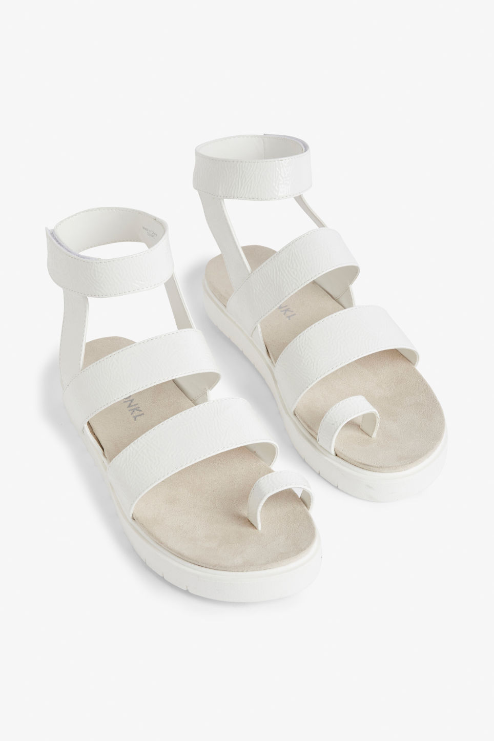Front image of Monki faux leather sandals in white