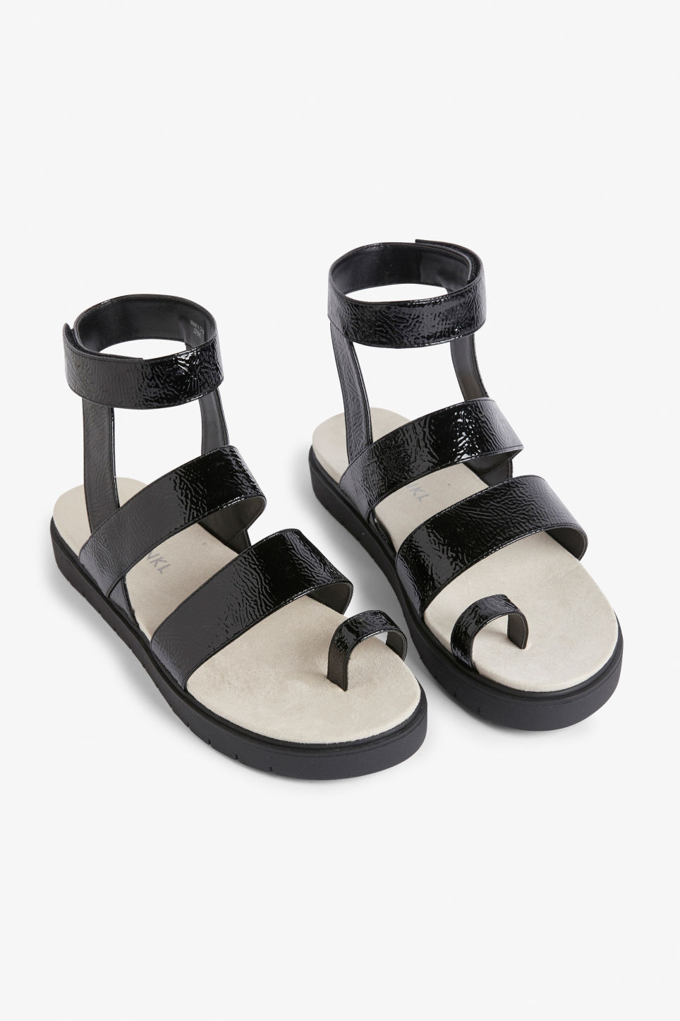 Front image of Monki faux leather sandals in black