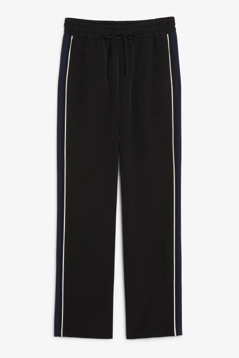 Front image of Monki dressy trousers in black