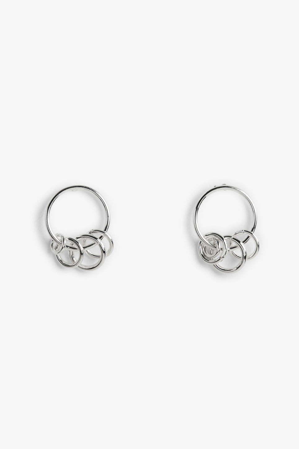 Front image of Monki silvery hoop studs in silver