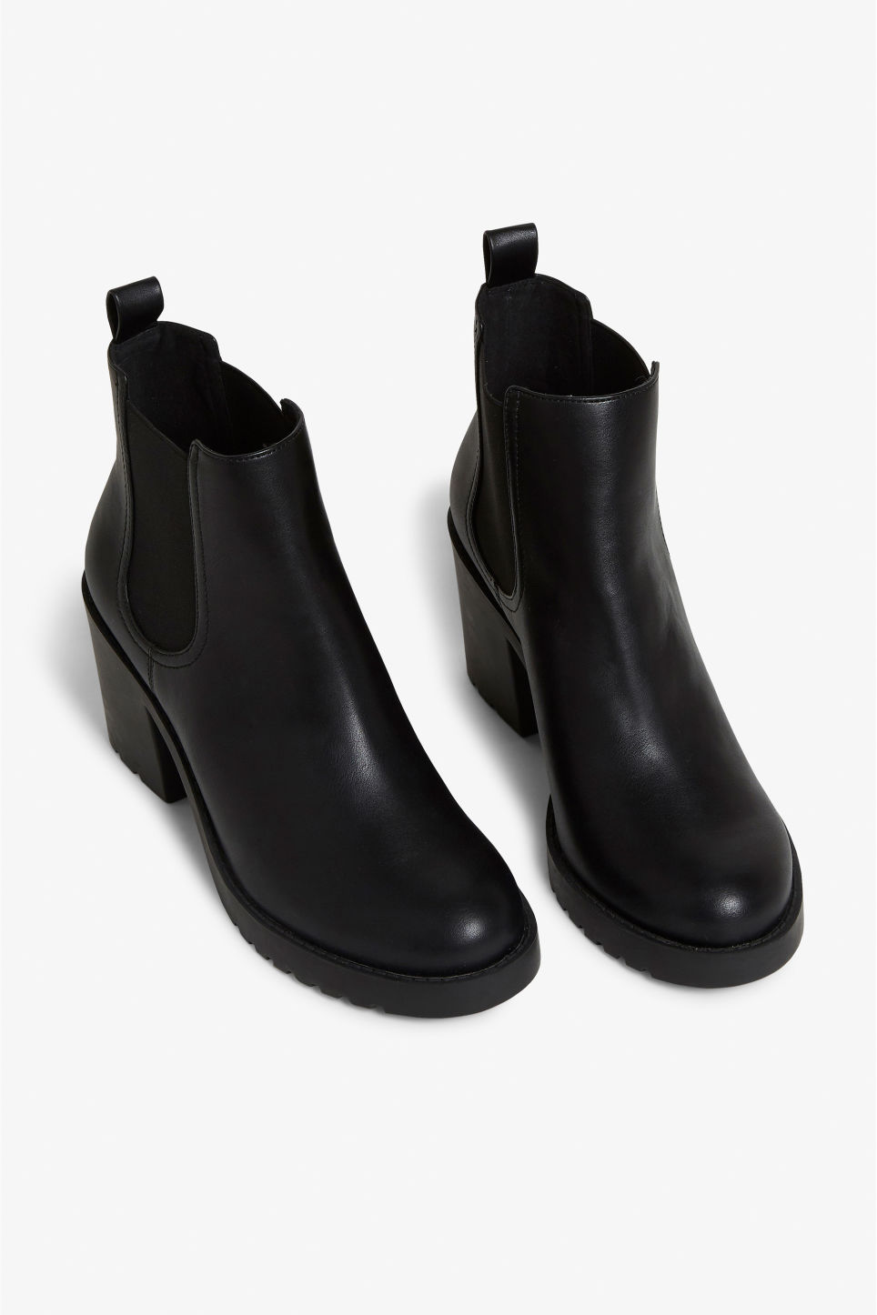 Front image of Monki stretchy ankle boots in black