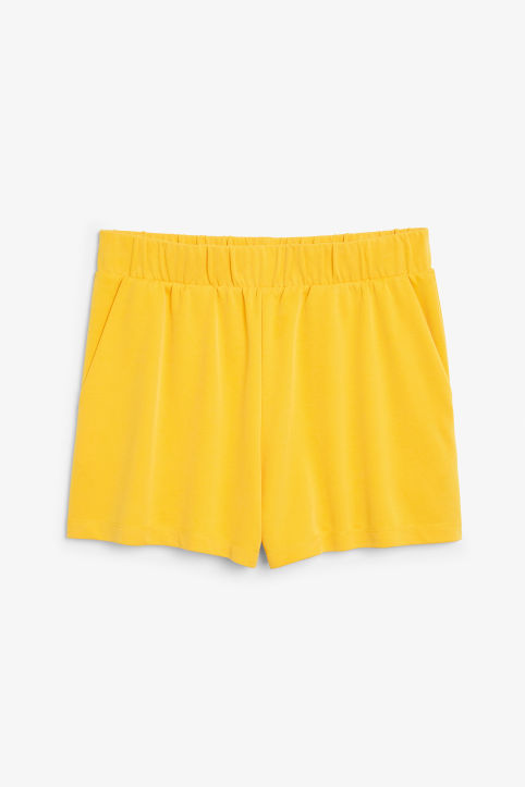 Front image of Monki super-soft sporty shorts in yellow