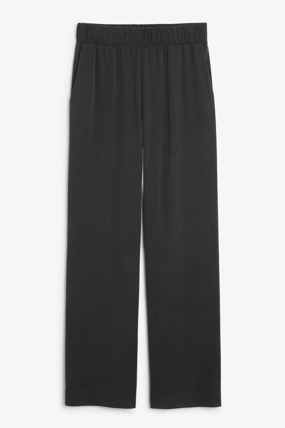 Front image of Monki super-soft flowy trousers in black
