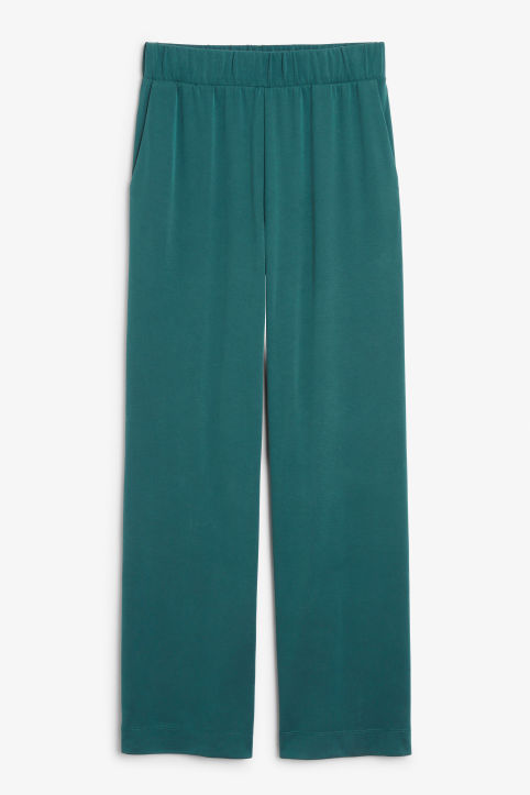 Front image of Monki super-soft flowy trousers in green