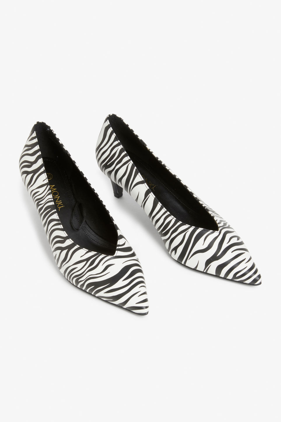 Front image of Monki zebra pumps in black