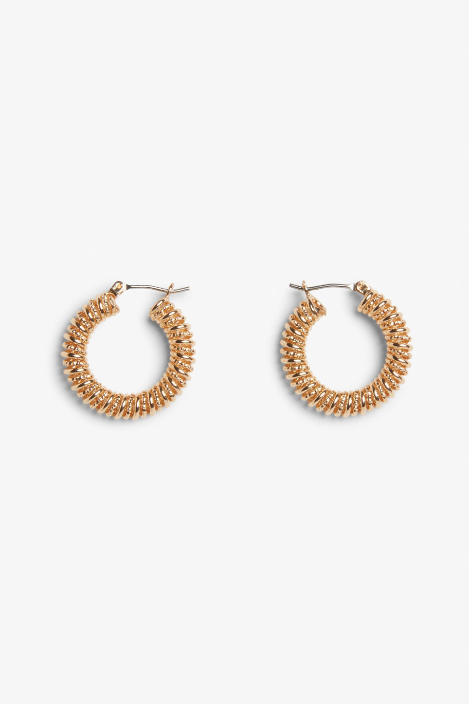 Front image of Monki twisted golden hoops in gold