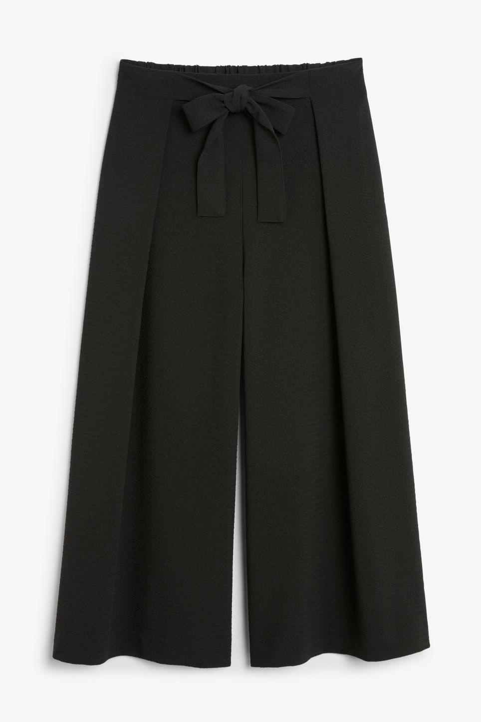 Front image of Monki wide leg trousers in black
