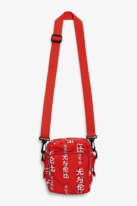 Front image of Monki utility style bag in red