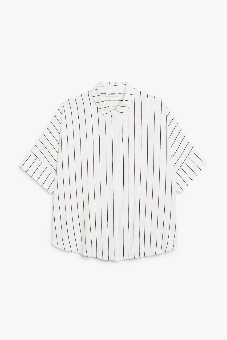 Front image of Monki oversized boxy shirt in white