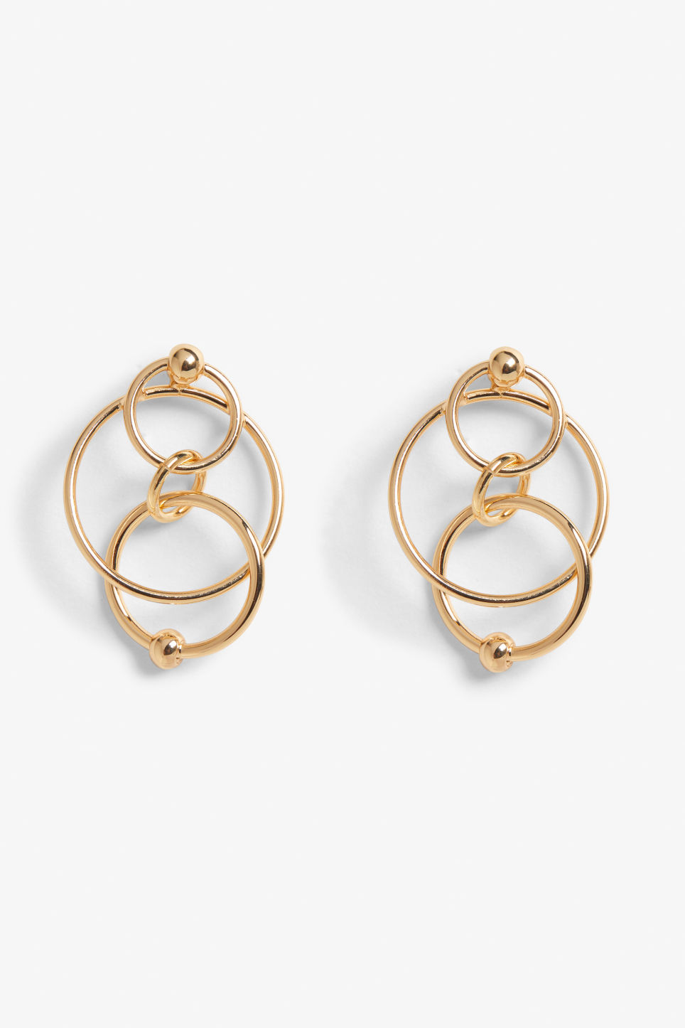 Front image of Monki stud earrings with hoops in gold