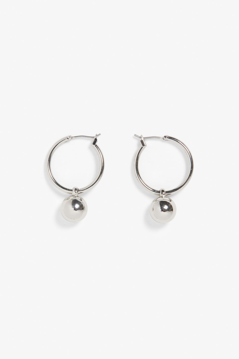 Front image of Monki irregular earrings in silver