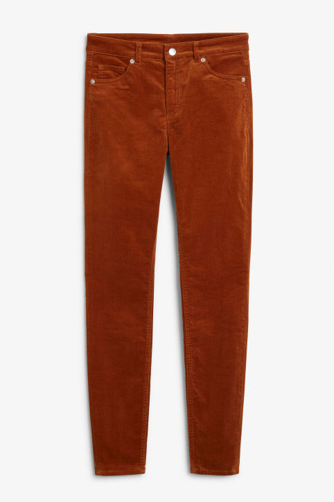 Front image of Monki corduroy trousers in orange