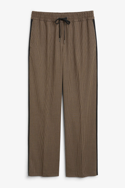 Front image of Monki sporty checked trousers in beige