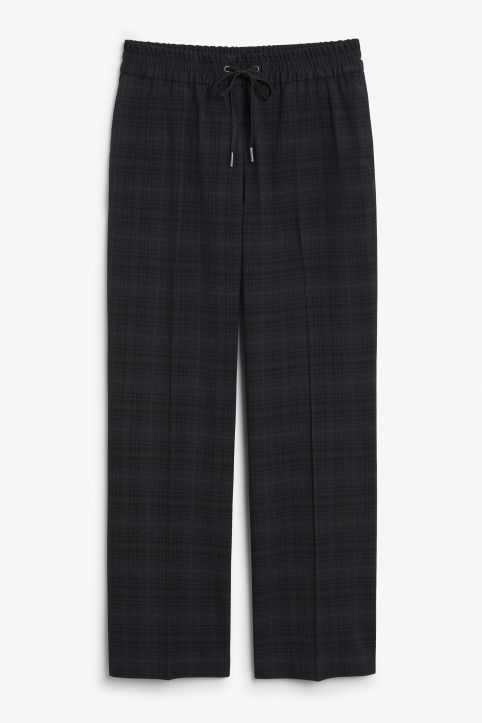 Front image of Monki sporty checked trousers in black