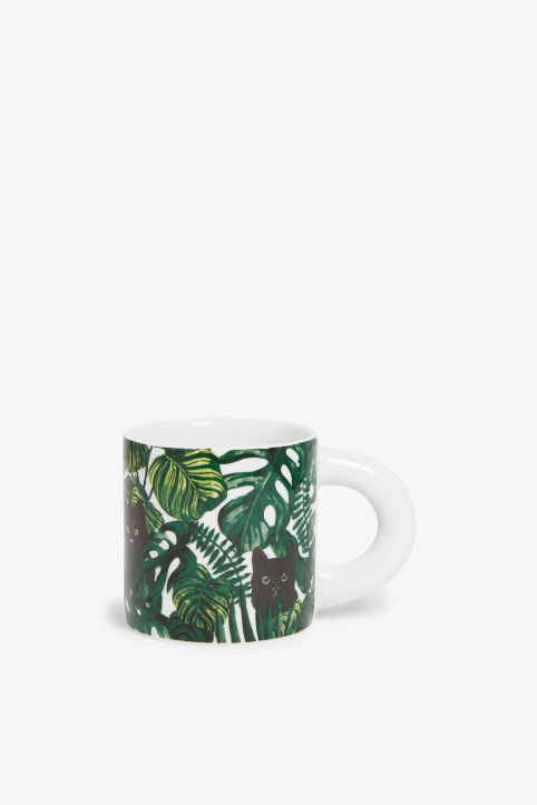 Front image of Monki porcelain mug in green