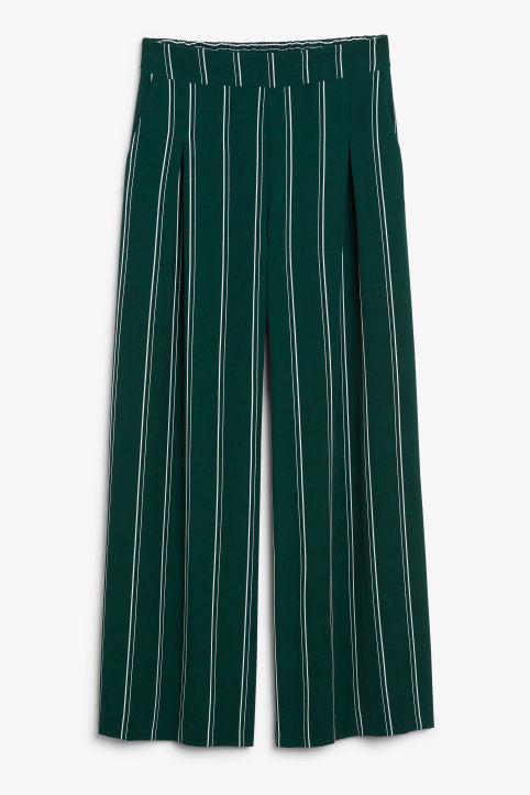 Front image of Monki wide flowy trousers in green