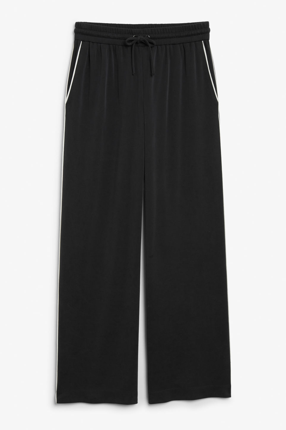 Front image of Monki super-soft trousers with contrast piping in black
