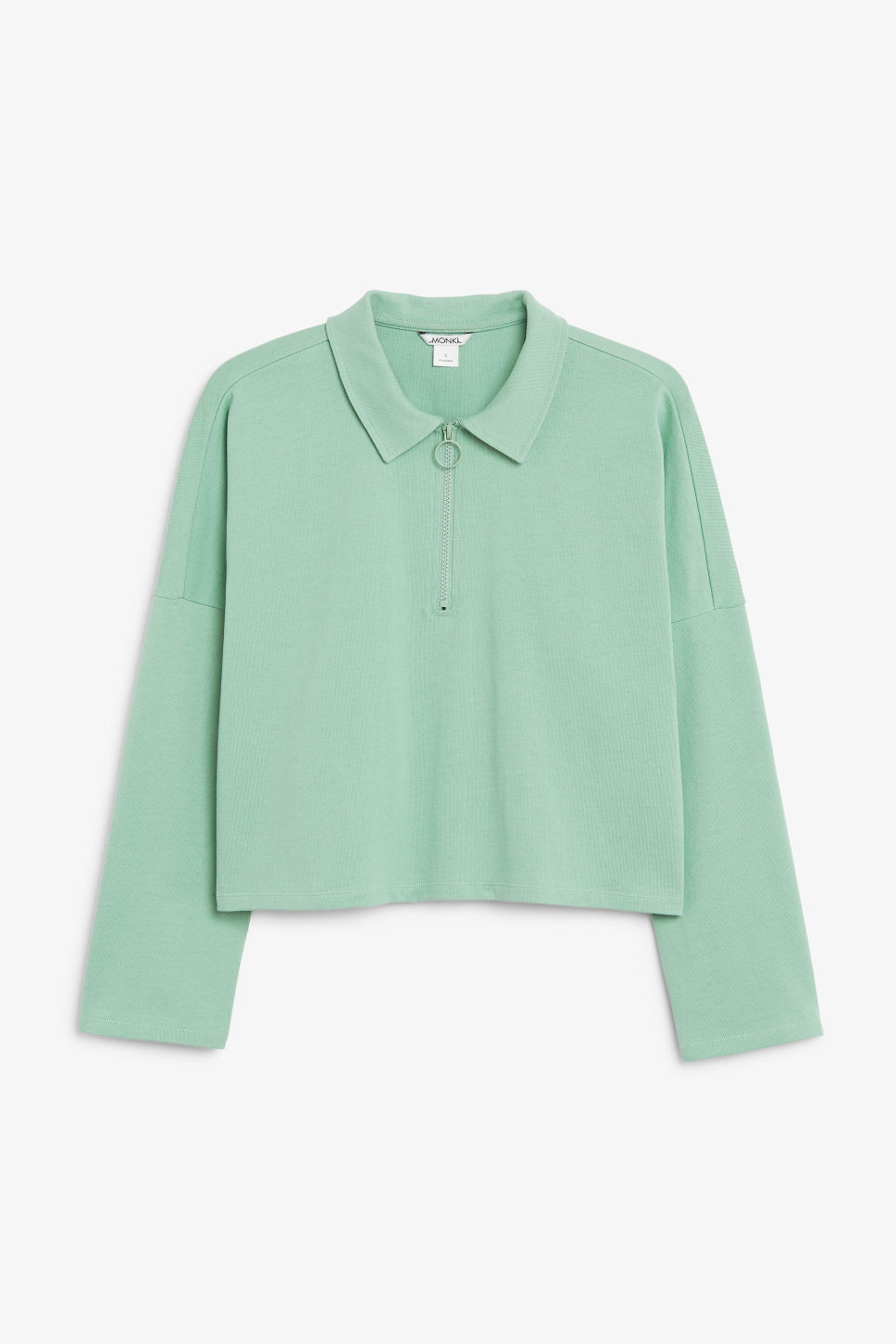 Front image of Monki front zip top in green