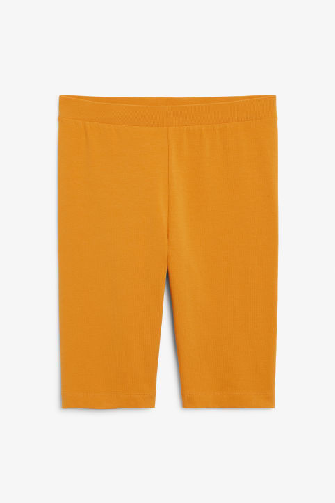 Front image of Monki short leggings in yellow