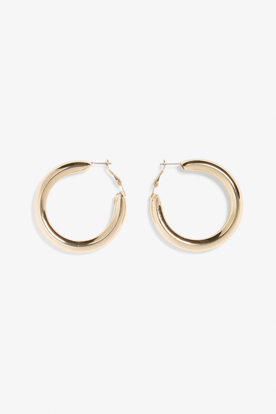 Front image of Monki chunky hoop earrings in gold