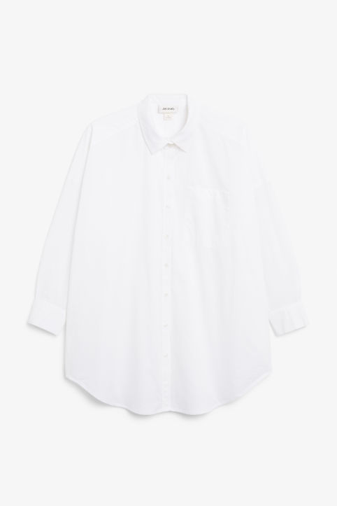 Front image of Monki below the hip blouse in white