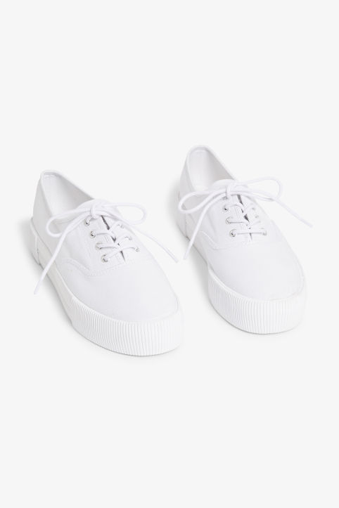 Front image of Monki platform sneakers in white