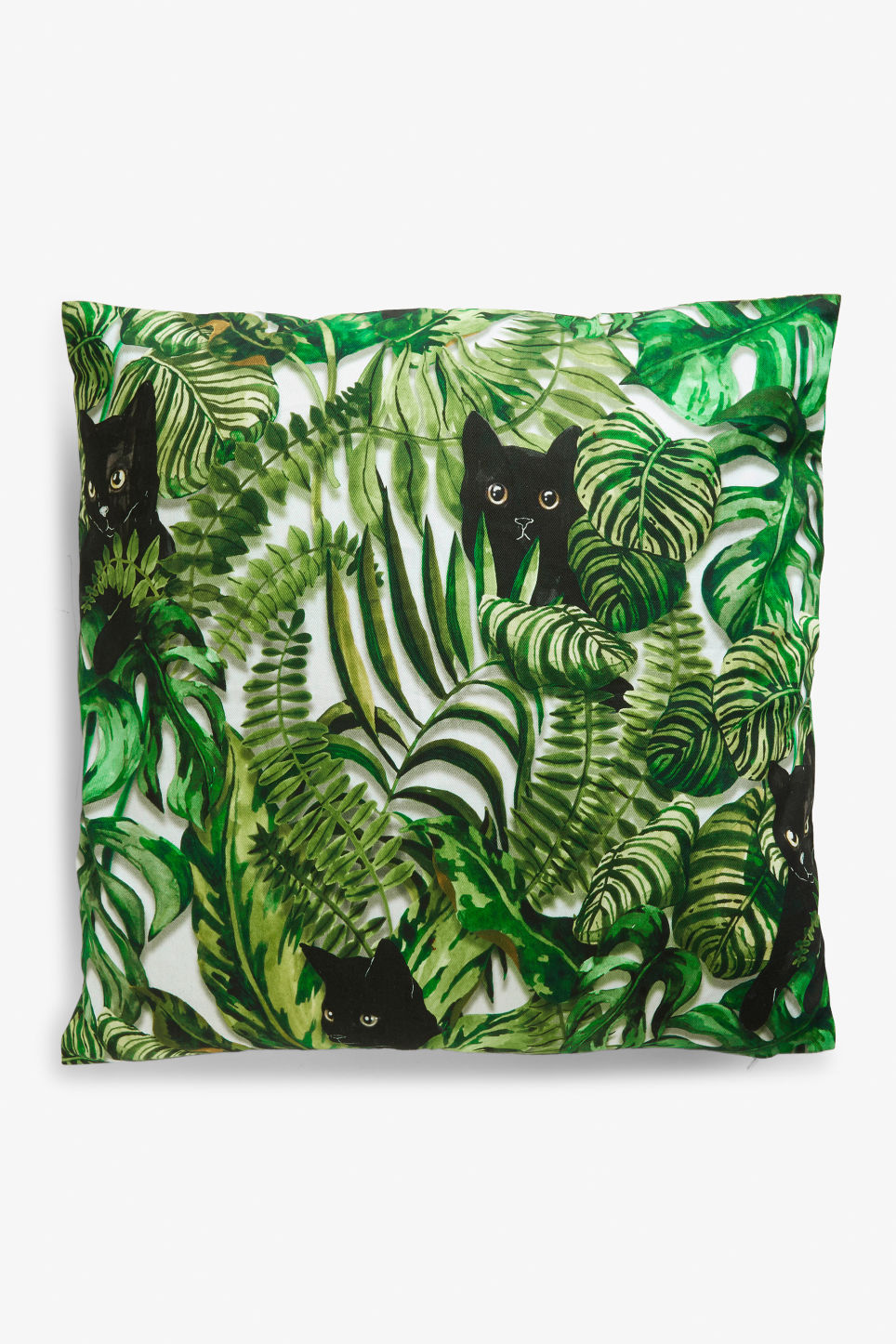 Front image of Monki cushion cover in green