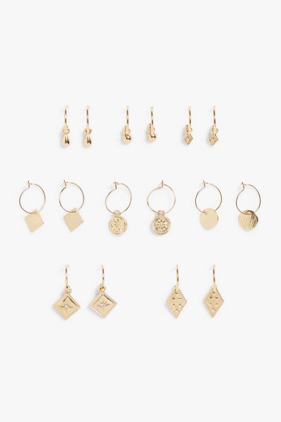Front image of Monki multiple gold earrings  in gold