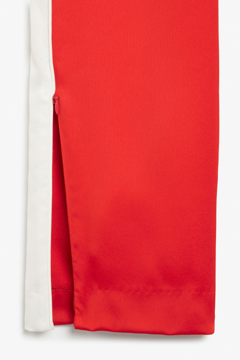 Detailed image of Monki side stripe trousers in red