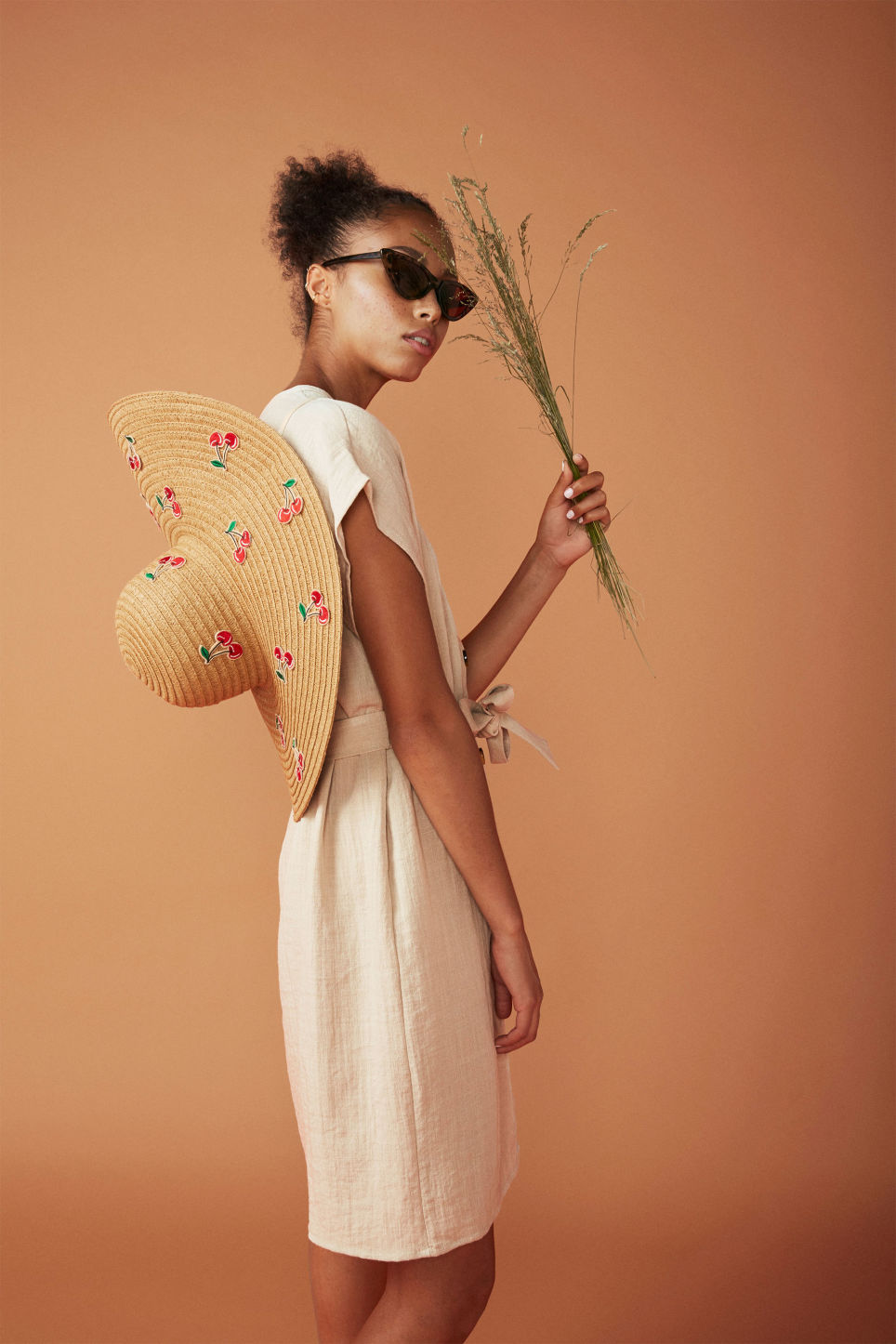 Detailed image of Monki cherry straw hat in beige