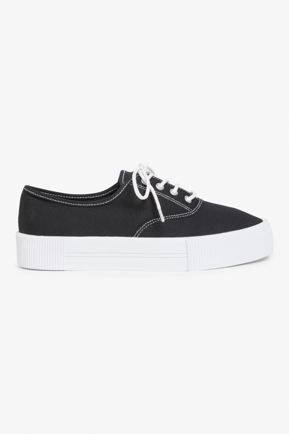 Detailed image of Monki lace-up sneakers in black
