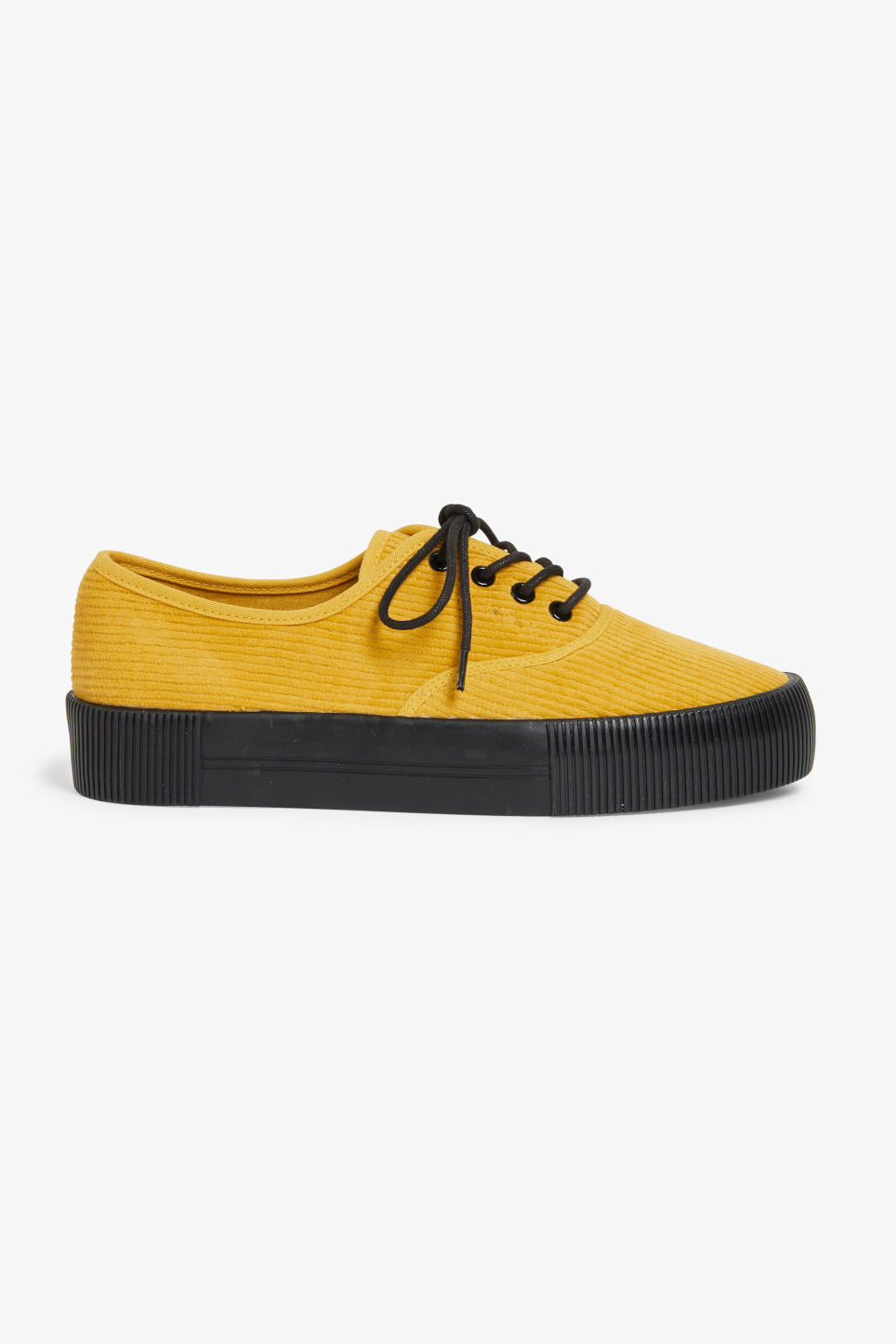 Detailed image of Monki lace-up sneakers in yellow