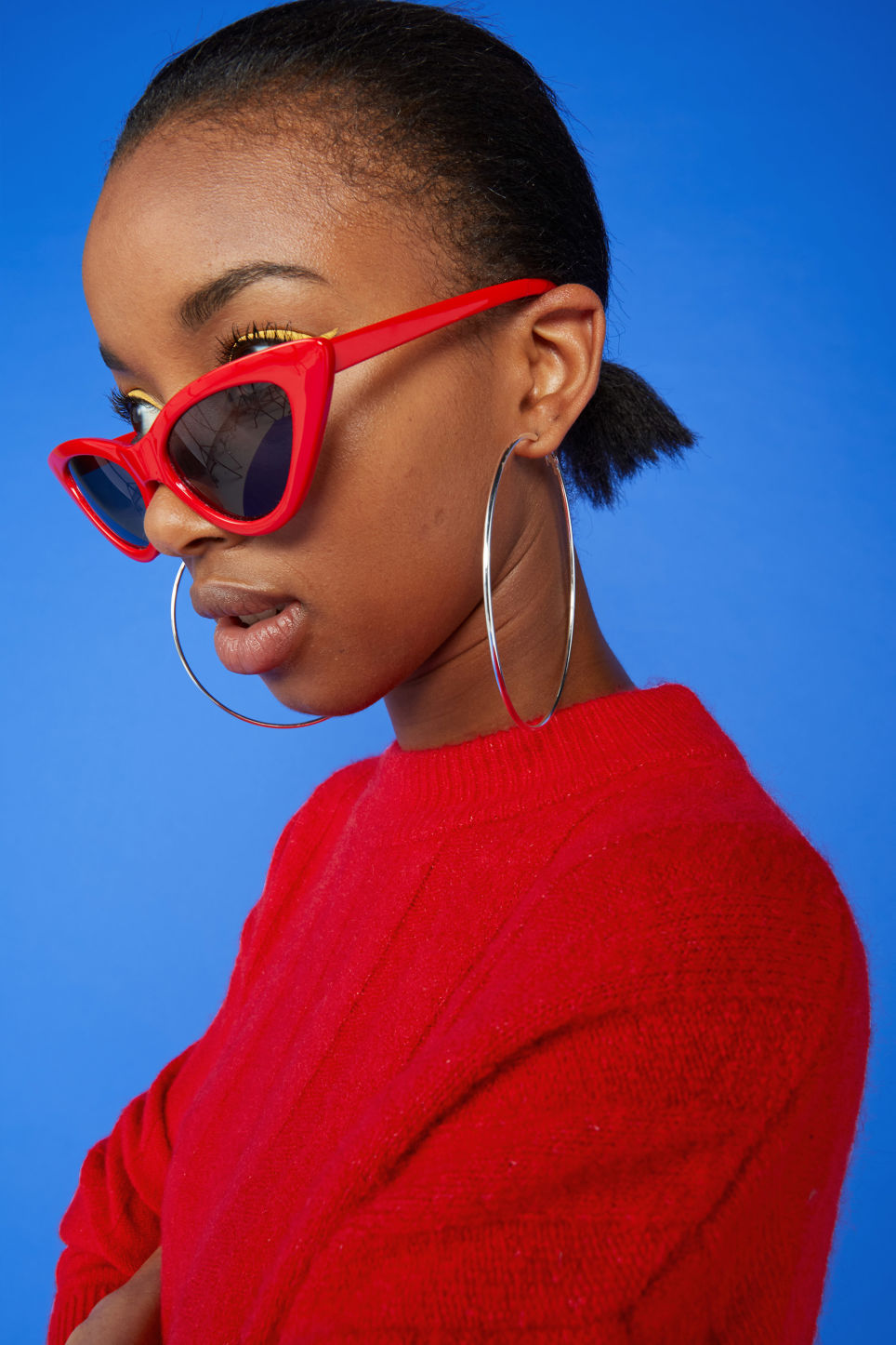 Detailed image of Monki cat eye sunglasses in red