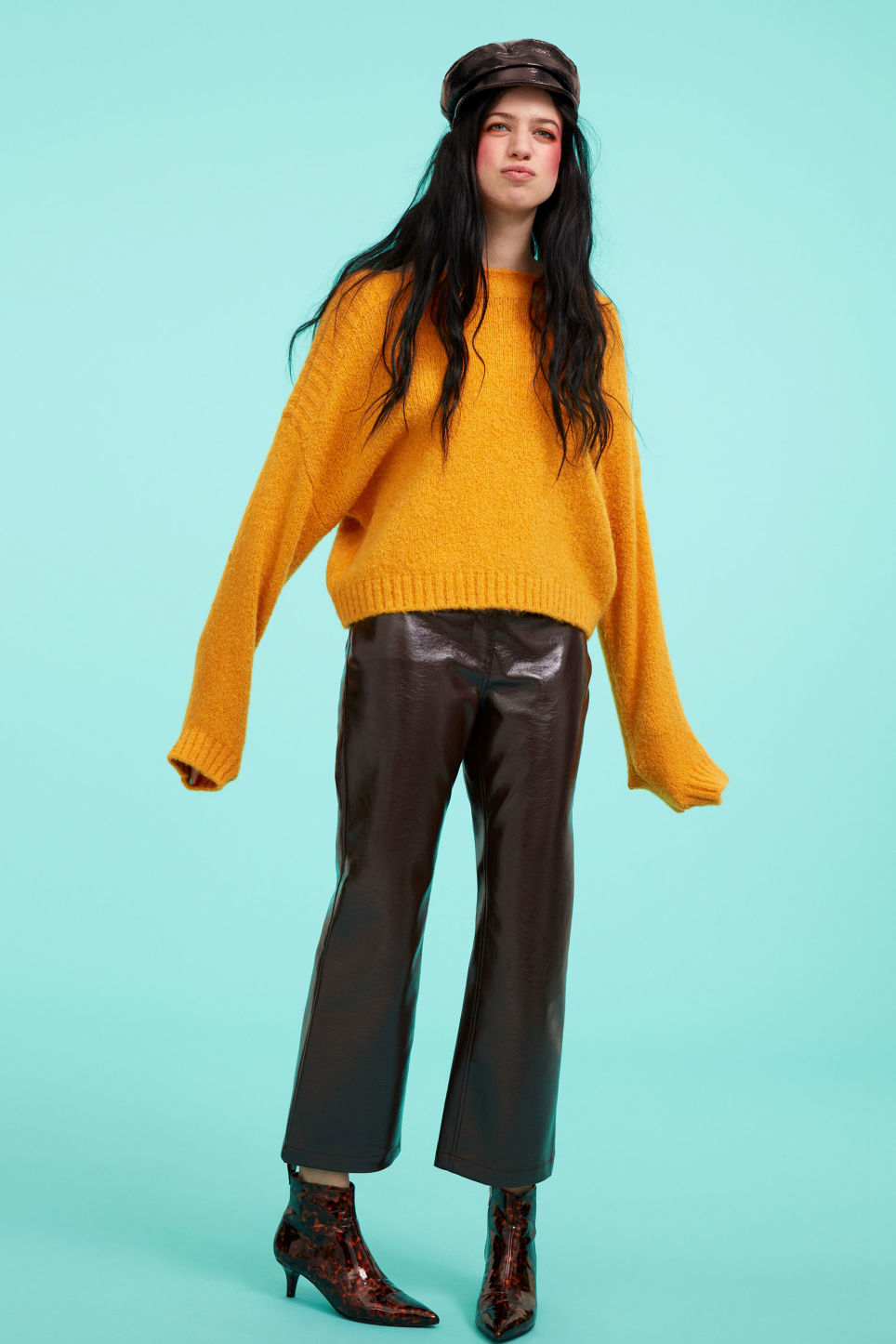 Detailed image of Monki faux patent leather trousers in brown