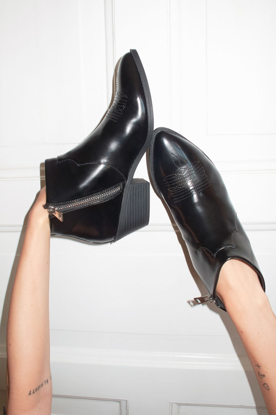 Detailed image of Monki black patent cowboy boots in black