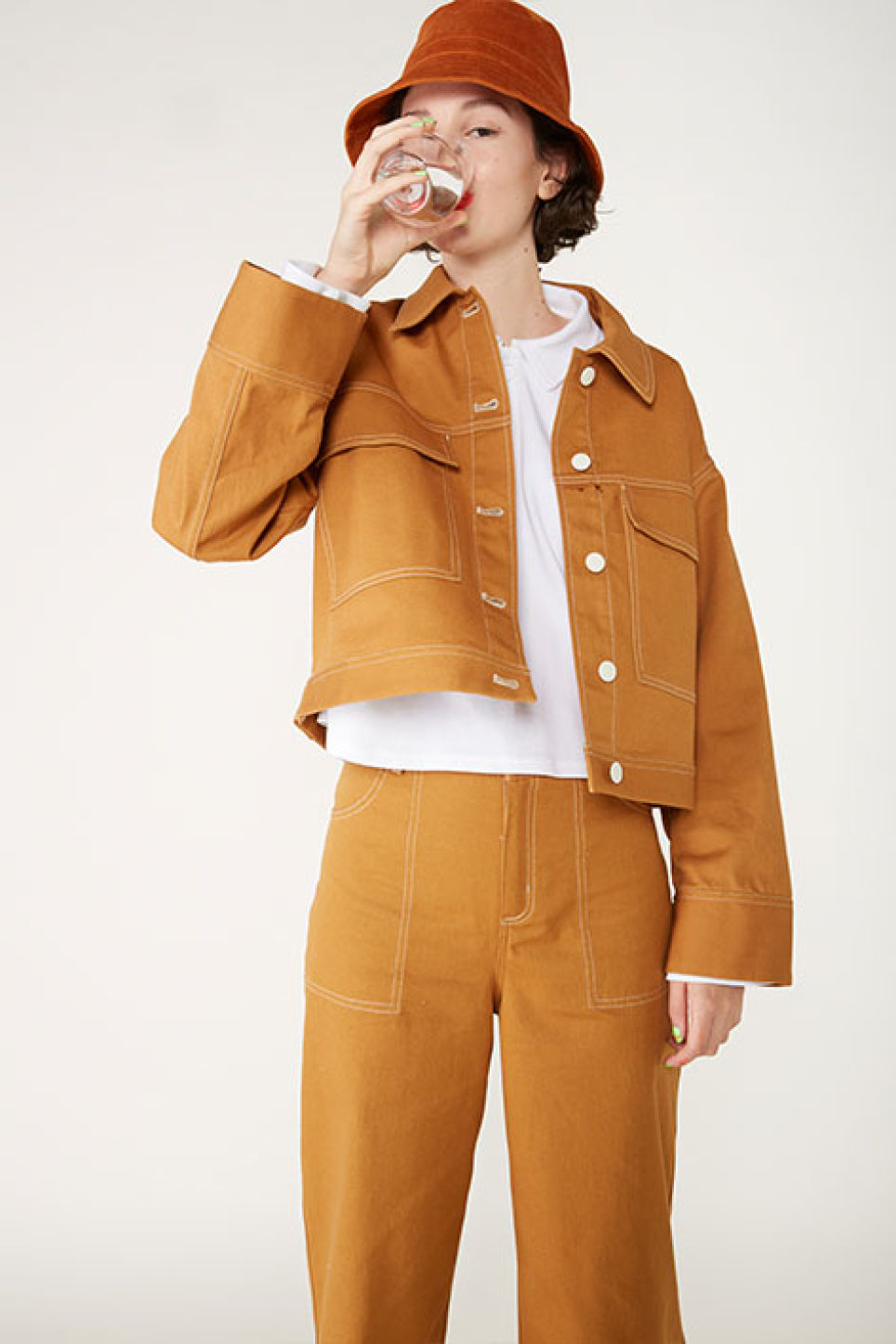 Detailed image of Monki cropped contrast stitch jacket in yellow