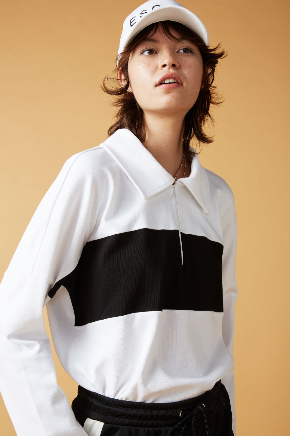 Detailed image of Monki spread collar polo in white