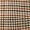 Fabric Swatch image of Monki houndstooth trousers in orange